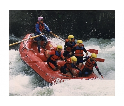 Action shot of Jo Deurbrouck raft guiding on the Lochsa River