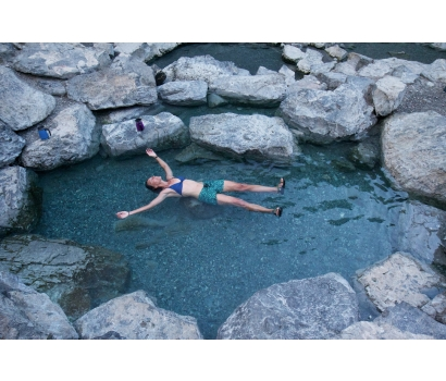 Jo Deurbrouck soaking in natural hot spring pool