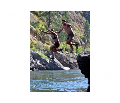 Jo Deurbrouck and her husband jumping from rocks on Salmon River